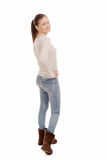 Pretty young woman standing on white background, back view Royalty Free Stock Image