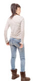 Pretty young woman standing on white background, back view royalty free stock photo