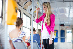 Pretty, young woman on a streetcar/tramway Royalty Free Stock Photo