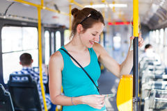 Pretty, young woman on a streetcar/tramway Stock Photography