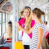 Pretty, young woman on a streetcar/tramway Royalty Free Stock Photos