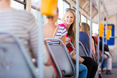Pretty, young woman on a streetcar/tramway Stock Images