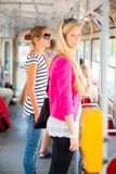Pretty, young woman on a streetcar/tramway Royalty Free Stock Images