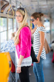 Pretty, young woman on a streetcar/tramway Stock Photos