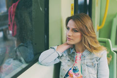 Pretty young woman on a streetcar/tramway, during her touristic. Trip, selective focus Stock Photography