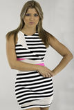 Pretty young woman is a striped casual dress Stock Photography