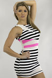 Pretty young woman is a striped dress Royalty Free Stock Images