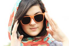 Pretty young woman and sunglasses Stock Images