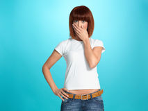 Pretty young woman with surprised face expression Royalty Free Stock Image