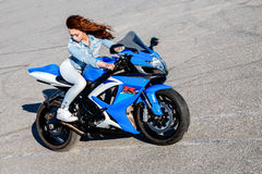Pretty young woman and Suzuki GSX-R750 Stock Photography