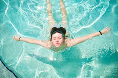 Pretty Young Woman Swimming royalty free stock images