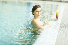 Pretty young woman in the swimming pool Stock Photography
