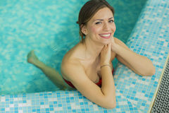 Pretty young woman in the swimming pool Stock Images