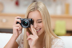 Pretty young woman taking a photograph Stock Photo