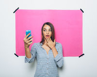 Pretty young woman taking picture with camera phone Royalty Free Stock Images