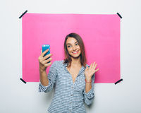 Pretty young woman taking picture with camera phone Royalty Free Stock Photo