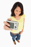 Pretty young woman taking a picture of herself Stock Photo