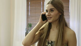 Pretty young woman talking by the cell phone and getting bad news. stock video