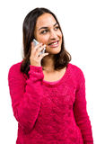 Pretty young woman talking on mobile phone. Against white background Royalty Free Stock Photos