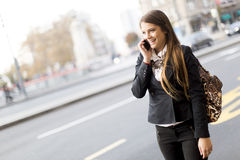 Pretty young woman talking on the mobile phone Royalty Free Stock Photo