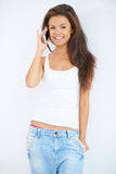 Pretty young woman talking on a mobile phone Stock Images