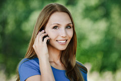 Pretty young woman talking phone Royalty Free Stock Photo