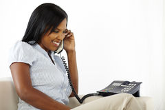 Pretty young woman talking at phone Stock Image