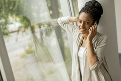 Pretty young woman talking on phone Royalty Free Stock Images