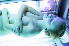 Pretty young woman tanning her skin Stock Photo