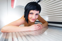 Pretty, young woman tanning her skin Stock Photos