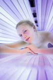 Pretty, young woman tanning her skin Royalty Free Stock Photos