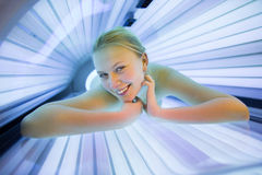 Pretty, young woman tanning her skin Royalty Free Stock Images