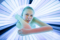Pretty, young woman tanning her skin Stock Photo