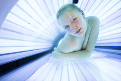 Pretty, young woman tanning her skin Stock Image