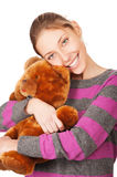 Pretty young woman with teddy bear Stock Photography