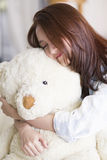 Pretty young woman with teddy bear Stock Photos