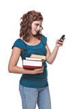 Pretty young woman text messaging. Pretty young woman, isolated against white background, text messaging Royalty Free Stock Photos