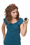 Pretty young woman text messaging. Isolated against white background royalty free stock photo