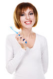 Pretty young woman with tooth-brush Stock Images