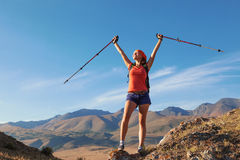 Pretty young woman tourist standing on top of mountain Royalty Free Stock Images