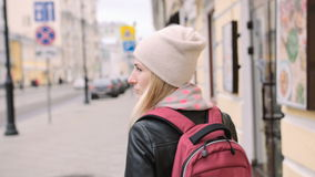 Pretty young woman tourist walk the streets of Moscow. Beatiful young girl tourist walk the streets of Moscow stock footage