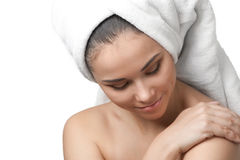 Pretty young woman with towel around her head Stock Images