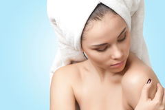 Pretty young woman with towel on her head Royalty Free Stock Photo