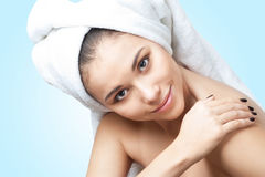 Pretty young woman with towel on her head Stock Photo