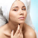 Pretty young woman with towel on her head Stock Image