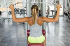 Pretty young woman training in the gym Stock Photo