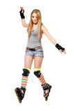 Pretty young woman tries to keep his balance. On roller skates Stock Photo
