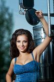 Pretty young woman and truck Royalty Free Stock Images
