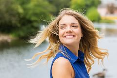 Pretty young woman turns her head. With flowing hairs Royalty Free Stock Image