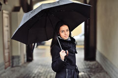 Pretty young woman with umbrella Royalty Free Stock Photo